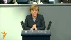 Merkel Warns Russia Of 'Massive' Damage Over Crimea