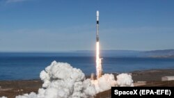 U.S. -- The Falcon 9 rocket lifts off while carrying a payload of 64 spacecraft during the Spaceflight SSO-A: SmallSat Express mission launch at Vandenberg Air Force Base in California, December 3, 2018
