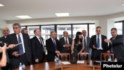 Armenia - Representatives of the governing coalition and the opposition Armenia National Congress begin landmark negotiations in Yerevan, 18Jul2011.