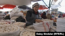 A woman sells dried curds at the central market in Bishkek, back to normal after April's violence.