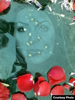The bullet-riddled gravestone of Neda Aqa Soltan, a young protester whose death during anti-government demonstrations in 2009 sparked international outrage. (file photo)