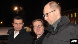 German Foreign Minister Guido Westerwelle, center, alongside Ukrainian opposition leaders Vitaliy Klitschko, left, and Arseniy Yatsenyuk.