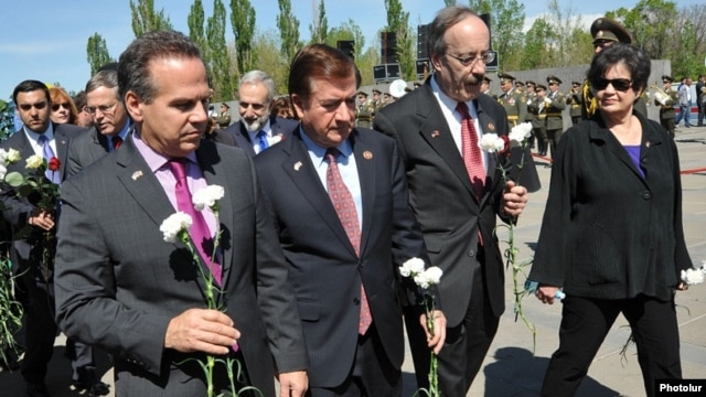 Armenia - Congressmen David Cicilline (L), Ed Royce (C) and Eliot Engel lay flowers at the Armenian Genocide memorial in Yerevan, 24Apr2014.