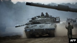 An Israeli tank maneuvers at an army deployment area near the Israel-Gaza Strip border on November 22.