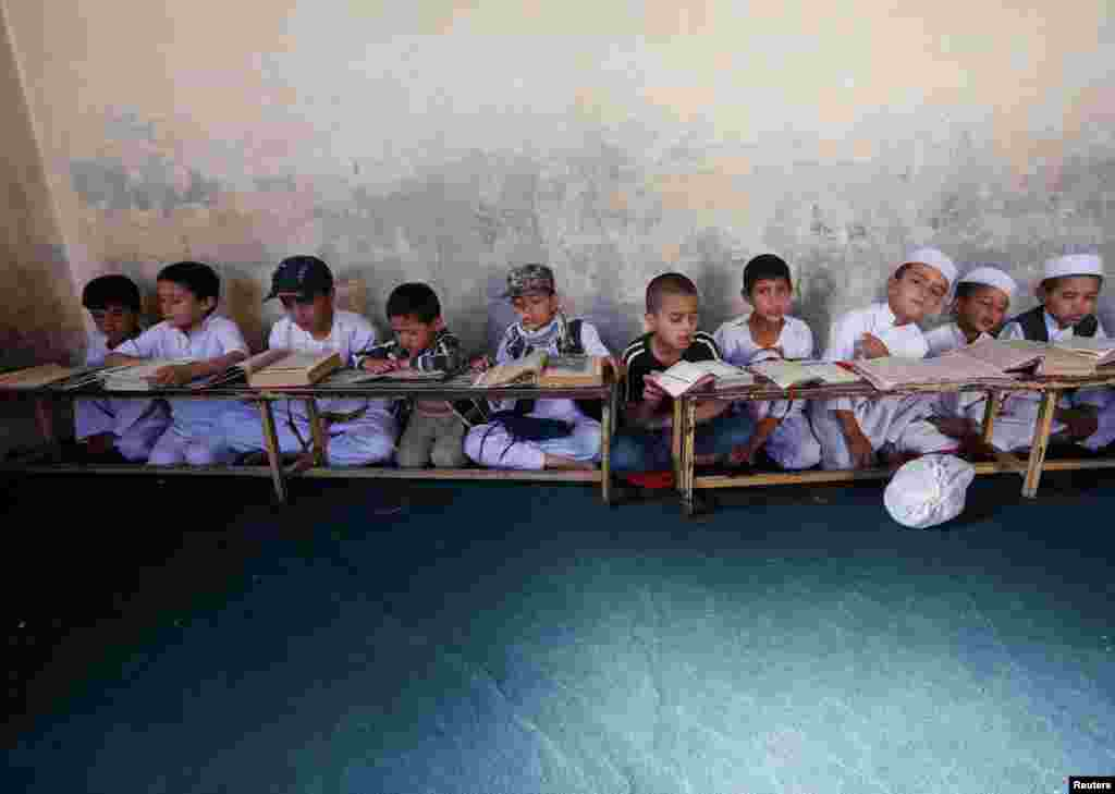 Afghan boys read the Koran in a madrasah, or religious school, during the Muslim holy month of Ramadan in Kabul. (Reuters/Omar Sobhani)