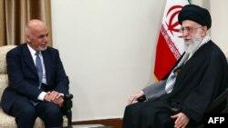 FILE: Iran's supreme leader Ayatollah Ali Khamenei with Afghan President Mohammad Ashraf Ghani in Tehran, April 2015.