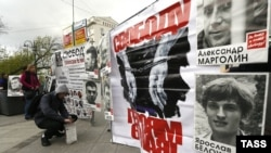 Portraits of Russian opposition protesters are displayed during a silent opposition rally in central Moscow on May 6.