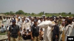 Displaced persons from South Waziristan receive rations in Pakistan's hard-hit Northwest Frontier Province