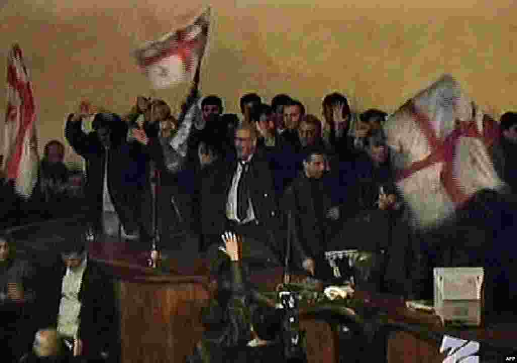 Georgian television shows opposition protesters waving flags inside the parliament on November 22.