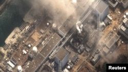 Japan - The No.3 nuclear reactor of the Fukushima Daiichi nuclear plant at Minamisoma is seen burning after a blast following an earthquake and tsunami in this handout satellite image taken 14Mar2011