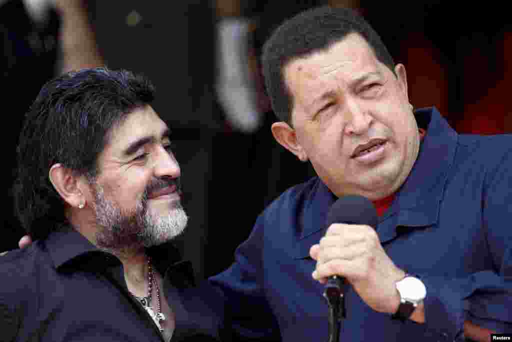 Chavez welcomes Argentina's soccer coach Diego Maradona at Miraflores Palace in Caracas in July 2010.