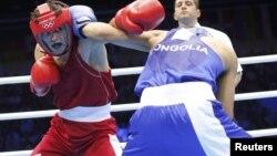 Лондон олимпиадасында рингке шыққан Моңғолия боксшысы. Лондон, 30 шілде 2012 жыл. (Көрнекі сурет)