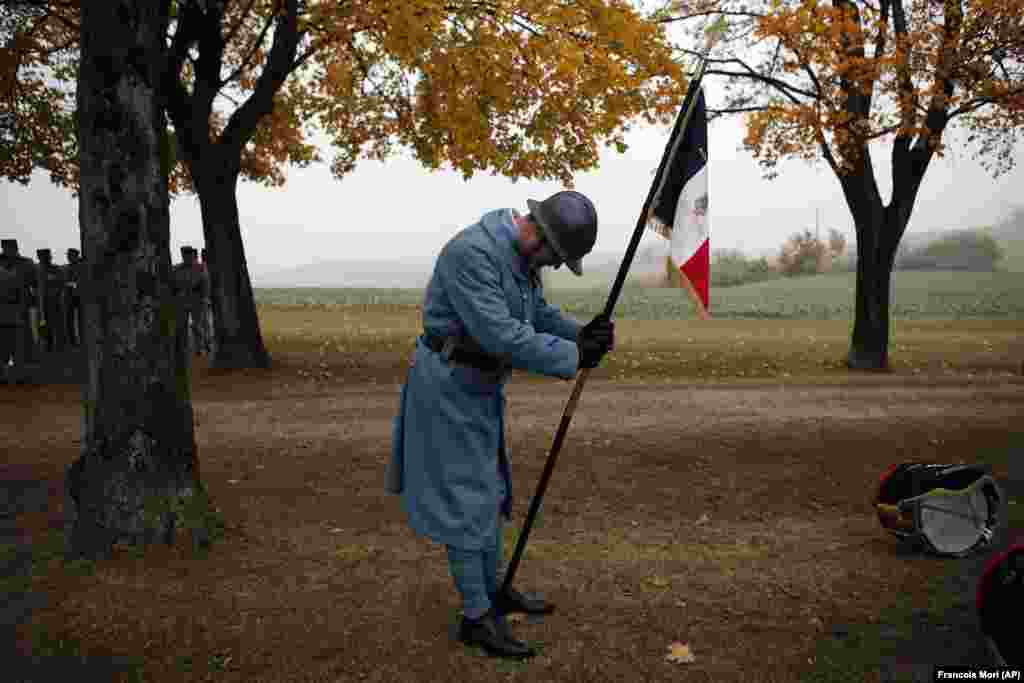 A military reenactment actor waits for the arrival of French President Emmanuel Macron during a ceremony marking the centenary of the end of World War I in the town of Morhange in eastern France. (AP/Francois Mori)