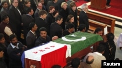 Men carry the casket of slain Pakistani Minorities Minister Shahbaz Bhatti.