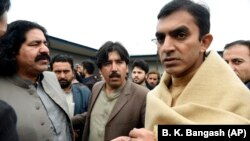 FILE: Leaders of the Pashtun Tahafuz (Protection) Movement or (PTM), Mohsin Dawar, right, and Ali Wazir, left, arrive at National Press Club in Islamabad, for a protest in January.