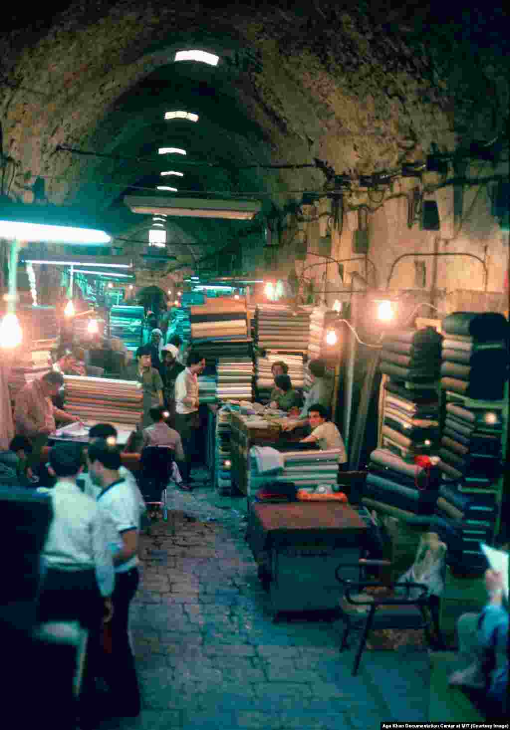 "A souq in Aleppo photographed in the 1980s. With its position on the Silk Road, the great trade route linking Asia and Europe, Aleppo became a famed merchant center where almost anything from East or West could be bought. In the corridors of the souq, it was said, ""Deals were more important than ideals."""