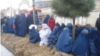 Displaced women from the Darzab and Qush-Teppa districts wait for assistance in Sheberghan.