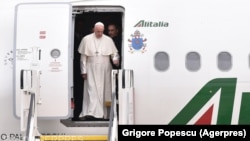 Pope Francis arrives at the Henri Coanda International Airport in Bucharest on May 31.