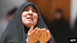 Мұса әл-Кадимге зиярат ете келген шиит мұсылман әйел. Бағдад, 15 маусым 2012 жыл.