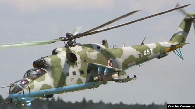 A Russian Mi-35 attack helicopter with transport capabilities
