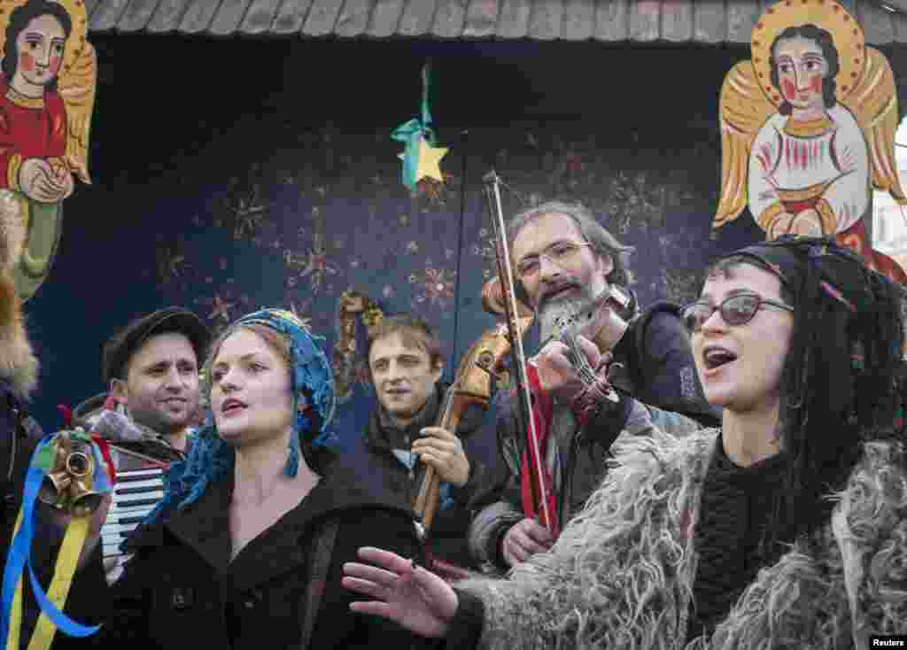 People sing carols as they celebrate Orthodox Christmas on Kyiv's Independence Square on January 7. (Reuters/Gleb Garanich)