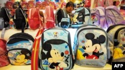 A vendor sells Mickey Mouse bags and other merchandise at a Disney flagship store in Shanghai, China.