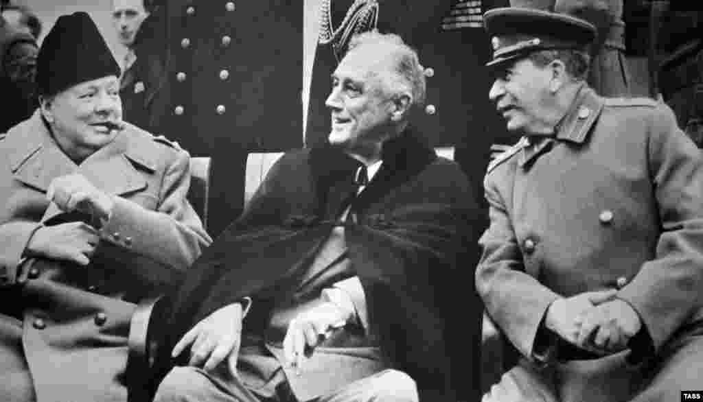 In February 1945, the leaders of the three main Allied powers met at a former tsarist palace outside the Crimean town of Yalta to discuss the final stages of the war against Germany and Japan and the postwar order. The meeting resulted in such key decisions as the agreement to accept only the unconditional surrender of Germany and to divide the country and the city of Berlin into four occupation zones. The Allies agreed to German reparations, including the use of forced labor. The Allies agreed to hand over to the Soviets all Soviet citizens regardless of their wishes. Stalin agreed to join the United Nations and to allow free elections in Poland. He also agreed that the Soviet Union would enter the war against Japan within 90 days after Germany's defeat. (British Prime Minister Winston Churchill (left), U.S. President Franklin Roosevelt (center), and Soviet leader Josef Stalin at the Yalta Conference in February 1945)