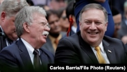 U.S. Secretary of State Mike Pompeo (right) and national-security adviser John Bolton (file photo)