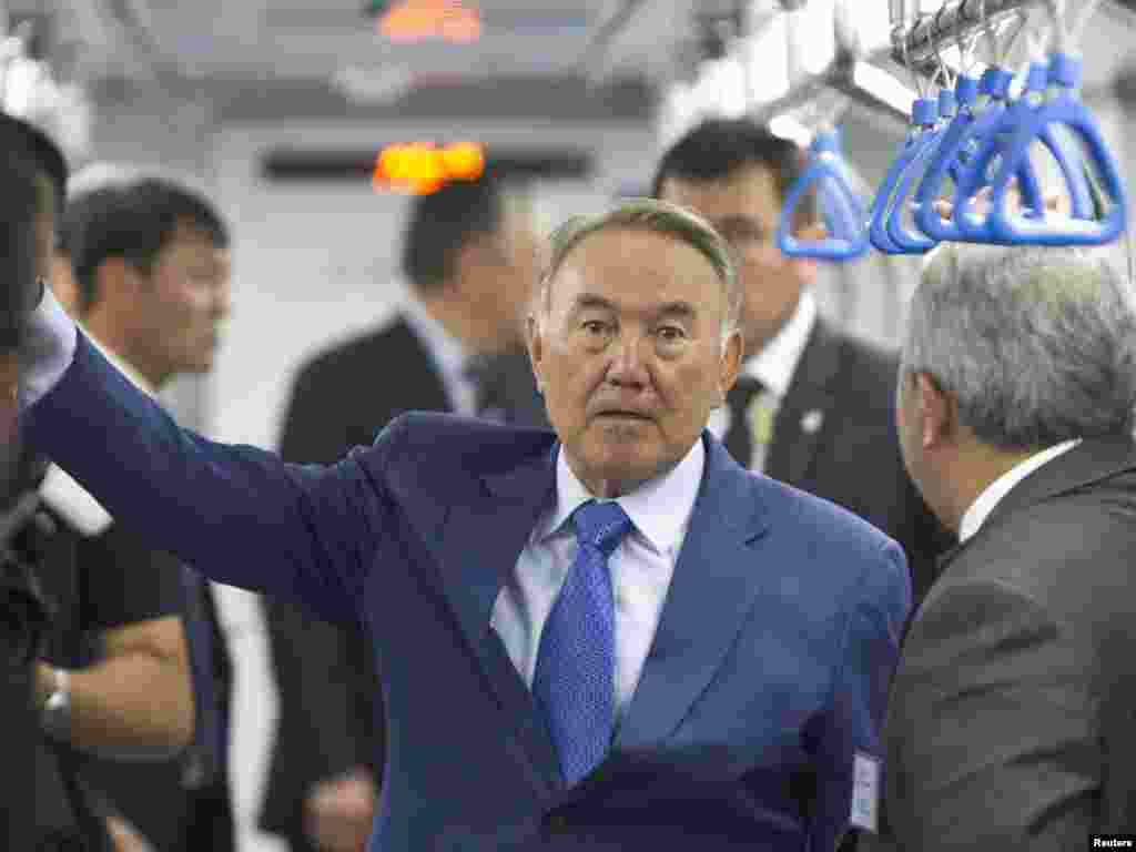 Kazakh President Nursultan Nazarbaev rides in a carriage during a visit to the Almaty subway. The Almaty subway will be opened later this year.Photo by Shamil Zhumatov for Reuters