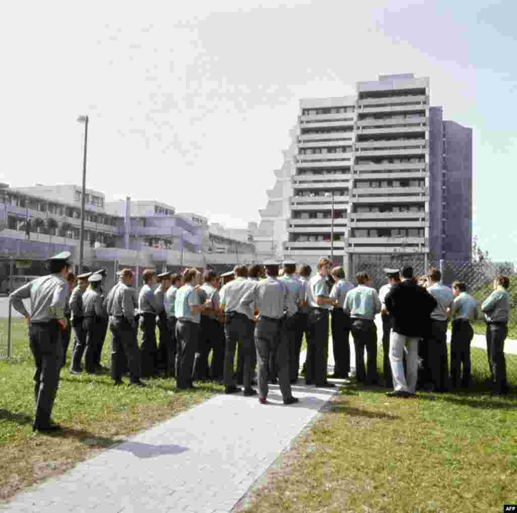 German police stand guard on September 6, 1972 at the fence demarcating the Munich Olympic village.
