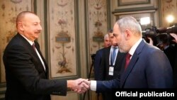 Germany -- Armenian Prime Minister Nikol Pashinian (R) and Azerbaijani President Ilham Aliyev meet in Munich, February 15, 2020.