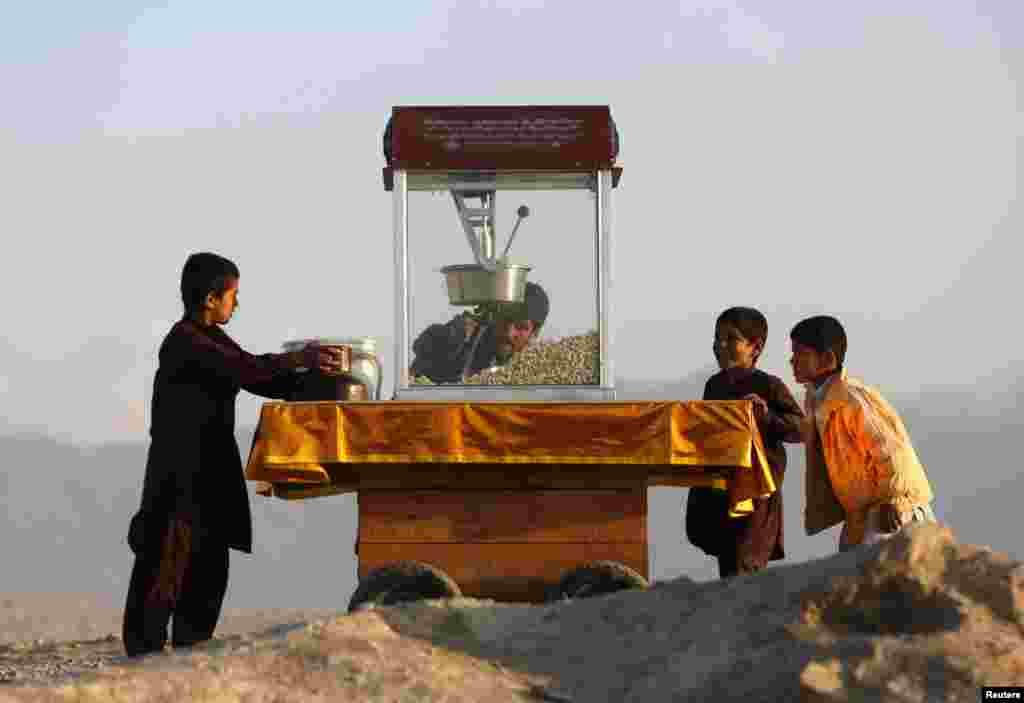 Children buy popcorn in Kabul on October 31. (Reuters/Mohammad Ismail)