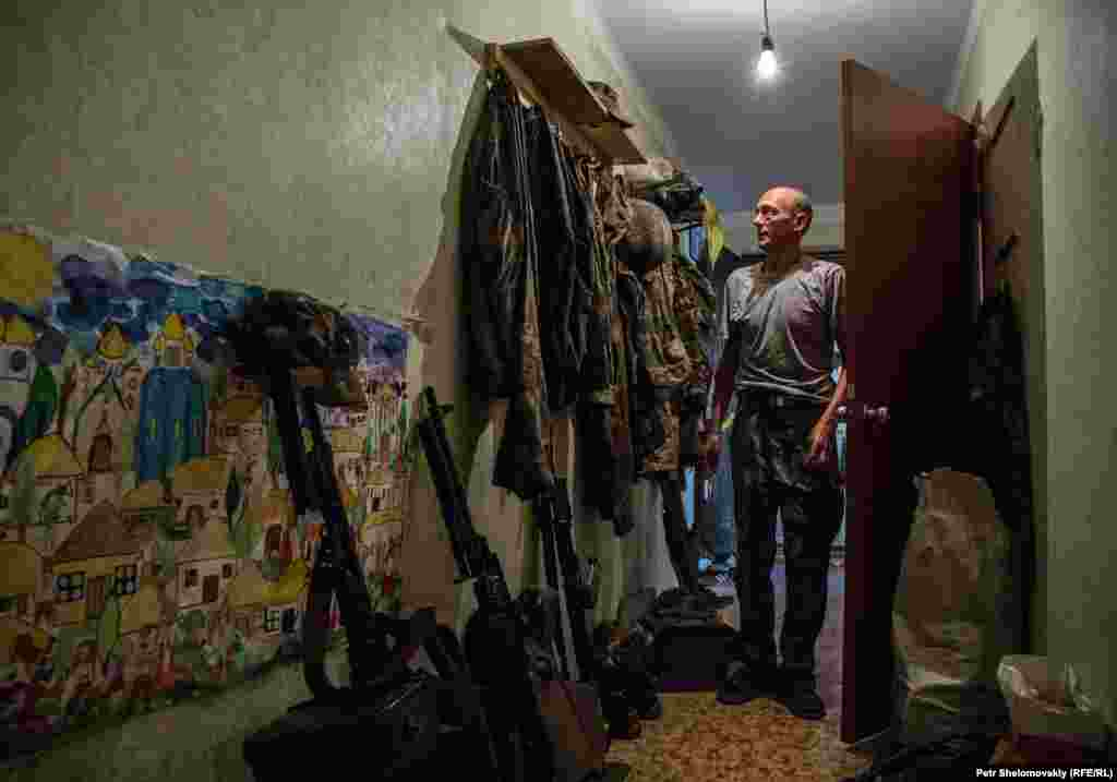 A Ukrainian serviceman at an apartment in Avdiyivka.