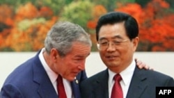 Presidents Bush (left) and Hu on August 8