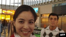Roxana Saberi and her father, Reza, on arrival from Iran at Vienna's airport on May 15