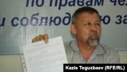 Есенбек Уктешбаев, руководитель НПО «Оставим народу жилье». Алматы, 20 мая 2014 года.