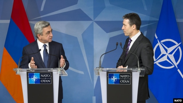 Belgium -- NATO Secretary-General Anders Fogh Rasmussen (R) and Armenian President Serzh Sarkisian speak at a news conference at NATO headquarters in Brussels, 06Mar2012