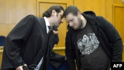 Kreshnik Berisha (right) listens to his lawyer as he arrives at court in Frankfurt in September.
