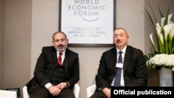 Switzerland - Armenian Prime Minister Nikol Pashinian (L) and Azerbaijan's President Ilham Aliyev meet in Davos, January 22, 2019.