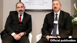 Armenian Prime Minister Nikol Pashinian (left) and Azerbaijani President Ilham Aliyev are shown during a meeting in Davos, Switzerland, in January.