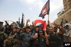 Иракские военнослужащие в центре Мосула. 9 июля 2017 года