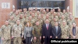 Armenia -- Armen Martirosian (C), the Armenian ambassador to Germany, poses for a photo with Armenian troops due to be deployed in Afghanistan, January 28 2010.