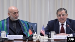 U.S. Defense Secretary Leon Panetta (right) with Afghan President Hamid Karzai during their meeting at the Pentagon.