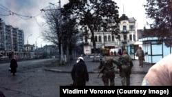 Women walk on Lenin Avenue