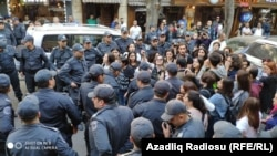 Some 50-60 people, mostly women, gathered in central Baku after police blocked the route of their planned march.