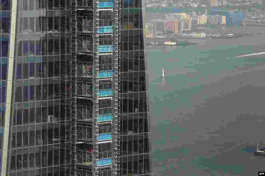 One World Trade Center is seen from the 72nd floor of a neighboring tower, Four World Trade Center. The reconstruction project at the site of the attacks has a projected price tag of $14.8 billion.
