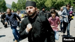 Orthodox clergy and Orthodox Christian activists clashed with gay-rights activists at a rally in Tbilisi marking International Day Against Homophobia on May 17.