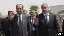 Prime Minister Nuri al-Maliki (left) tours the Kurdish city of Halabja.