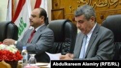 محافظ البصرة خلف عبد الصمد (يمين) ورئيس مجلسها صباح البزوني