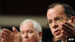 U.S. Chairman of the Joint Chiefs of Staff Admiral Mike Mullen testifies before the Senate Armed Services Committee on February 2, with Defense Secretary Robert Gates looking on.